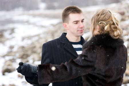 Couple in love dancing outdoors. Winter season. photo