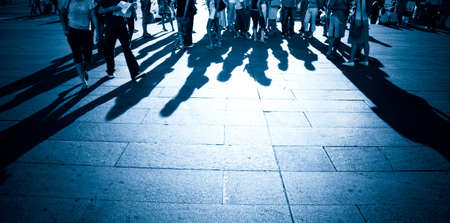 People shadows on a ground. Blue tint. photo
