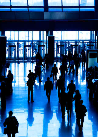 many windows: Walking business people silhouette. Blue tint. Stock Photo
