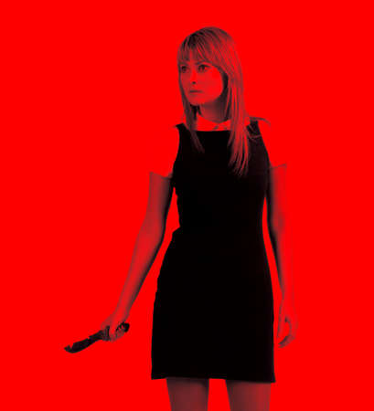Aggressive woman with knife. Stylize image in blood red color. photo