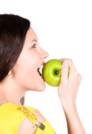 Young woman biting green apple. Isolated on white. Stock Photo - 5304041