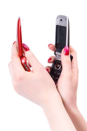 flip phone: Two woman hands with red and black mobile phone. Isolated on white.