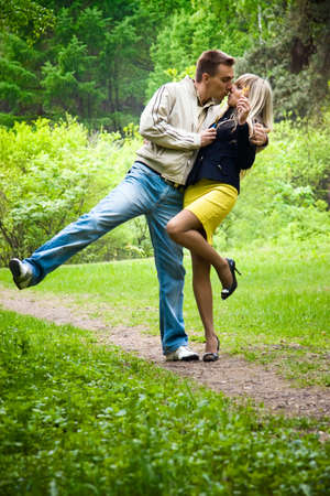 tender tenderness: Young happy couple kissing in a park. Stock Photo