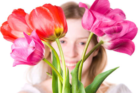 Young happy woman with flowers. Isolated on white. photo