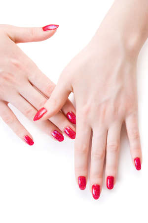 Beautiful woman hands with red nails. Isolated on white. photo