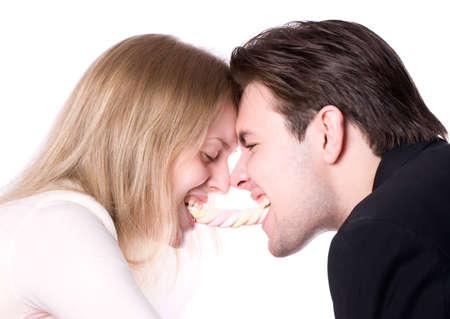 Man and woman fighting for a sweets. Isolated on white.