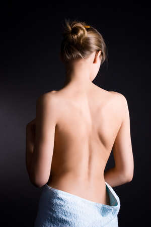 black women nude: Young woman with naked back. On dark background.