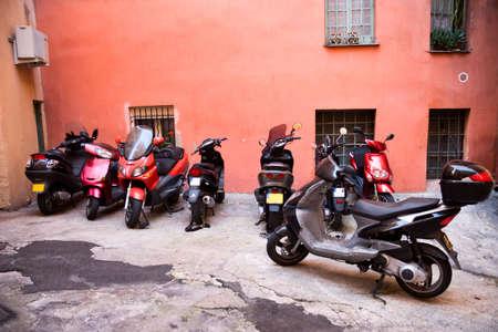 Italian narrow street with motor bikes. photo