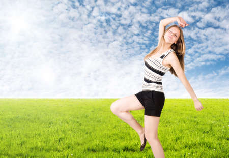 Young woman goes in for sports on nature. photo