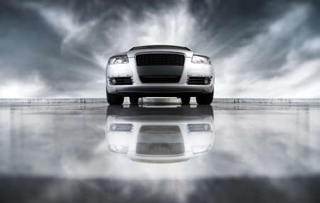 Modern car front view. On sky background and with reflection. Stock Photo - 5412669