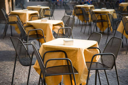 Cafe tables outdoors. Focus on front table. photo