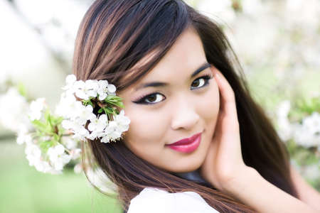 Young woman with cherry flowers. Shallow dof effect. Stock Photo - 5406740