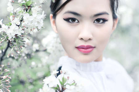 Young woman with cherry flowers. Shallow dof effect. Stock Photo - 5406683