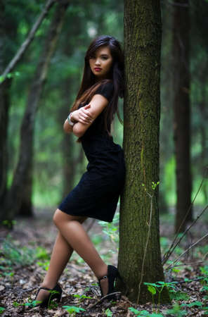 Young woman in forest. Shallow dof. Stock Photo - 5406684