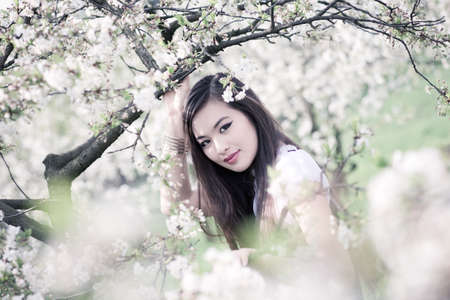 Young woman with cherry flowers portrait. Stock Photo - 5406676