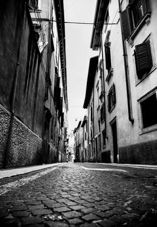 slum: Urban slum. Narrow Italian street. High contrast black and white colors.
