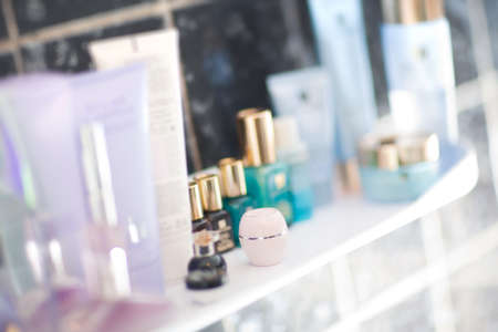 parfum: Table with perfumery and creams. Shallow dof effect.