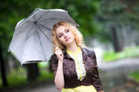 Young woman with umbrella in a rainy weather. photo