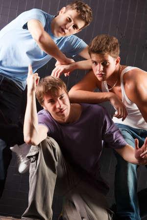 Male dancer team. On dark wall background. photo