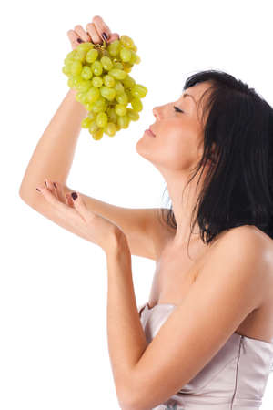Young woman with grapes portrait. Isolaed on white. photo