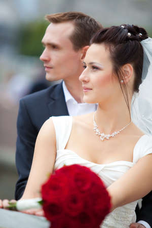 Young wedding couple portrait. Profile view. photo