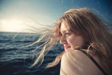 Young woman sea travel concept portrait. photo