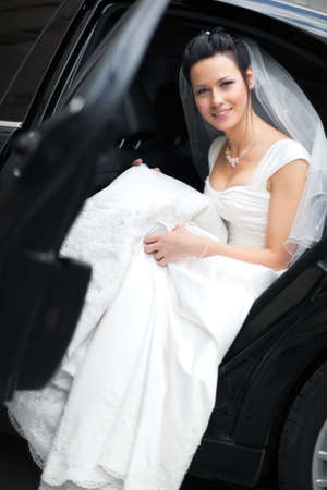 Young bride in luxury car. photo