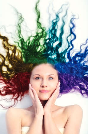 hand colored: Young woman with long curly hair. Rainbow colored hair.
