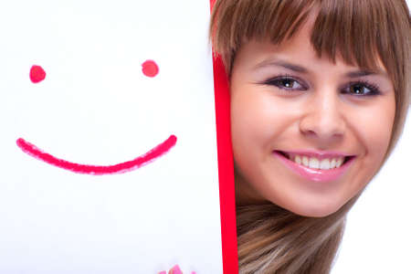 Young woman with smile symbol. On white. photo