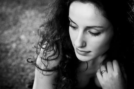 Young woman pensive portrait. Black and white. photo