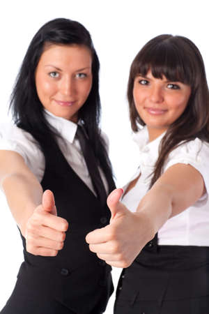 handsignal: Two young women showing success handsign. Isolated on white.