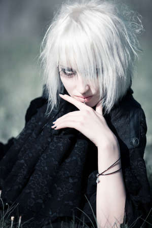 imperious: Goth woman with white hair outdoors portrait.