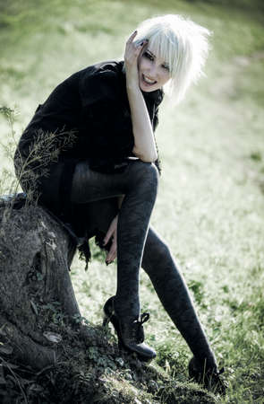 freaky: Goth woman outdoors. Freaky concept. Stock Photo