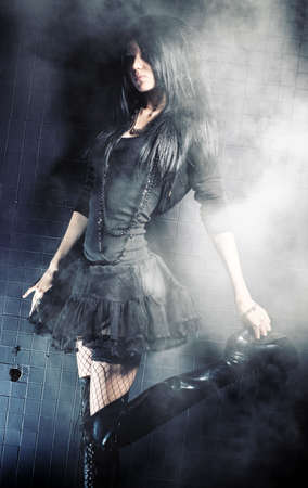 Goth woman fashion. On black wall background. photo