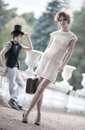 Young couple fashion. Young walking lady and gentleman. photo