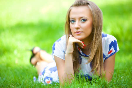 Young woman lying on green grass. Stock Photo - 5736155