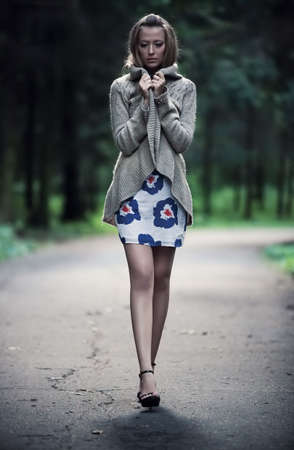 Young lonely woman walking in a park. Stock Photo - 5736191
