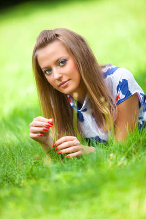 Young woman lying on green grass. Stock Photo - 5736153