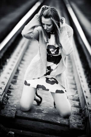Woman at the railway concept. Contrast black and white colors. Stock Photo - 5736144