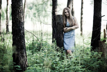 Young woman in a forest. Contrast colors. photo
