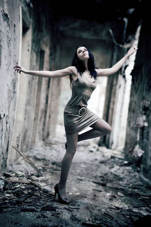 industrial ruins: Young woman in a ruined building. Lens distortion effect for more dramatic.
