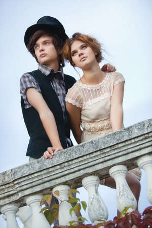 Young elegant couple standing at the railing. photo