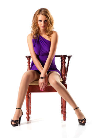 Young woman on a chair. Isolated on white. Stock Photo - 5857996