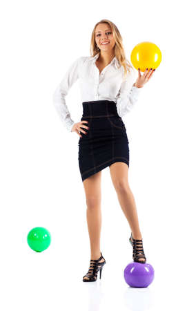 Young businesswoman with balls. Isolated on white. photo
