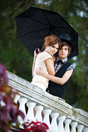 Young couple standing in the rain. Stock Photo - 6077343