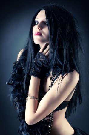 Goth woman fashion. On dark background. photo