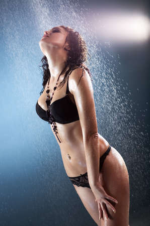 Young sexy woman. Water studio  photo