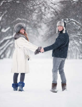 Young couple walking in a park. Winter season. Stock Photo - 6204435
