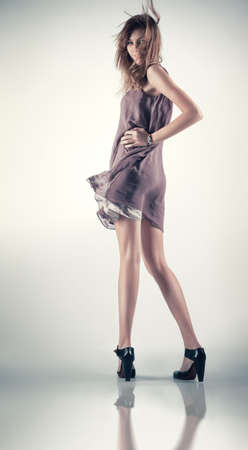 Young slim woman in fluttering dress. photo