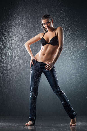 Young sexy woman. Water studio photo. Stock Photo